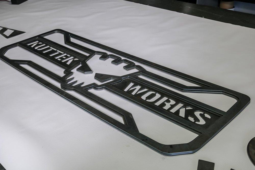 Layered metal sign